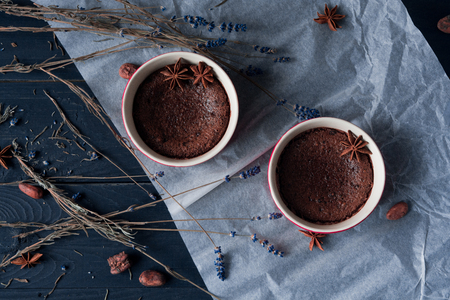 Brownie, chocolate fondant, lava cake  on dark blue background, close up Reklamní fotografie
