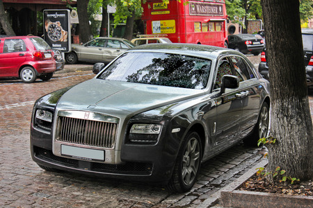 August 5, 2012, Kiev, Rolls-Royce Ghost. English car on the background of the British bus. The car in the rain. Raindrops. Editorial photo.