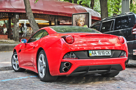 Kiev, Ukraine; April 27, 2015. Ferrari California in the street. Speed. Tuning. very expensive. Car. Karbon. Race. City. Luxurious. Tuning. Supercar. Italy. Editorial photo. Editorial
