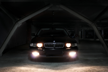 December 23, 2014, Odessa, Ukraine. underground parking. BMW 7 (e38) in the shadows with glowing lights in low light. Car. Editorial photo.