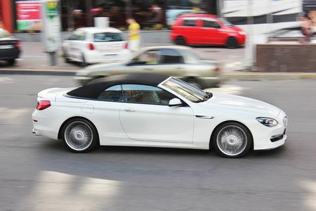 August 8, 2015; Kiev, Ukraine, Downtown. BMW Alpina B6 Cabriolet. White convertible. Editorial photo.