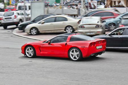 Kiev, Ukraine; April 3, 2014; Chevrolet Corvette in motion. Red supercar. Editorial photo. Editorial