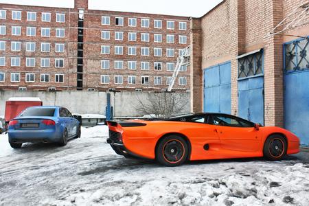 January 3, 2013; Kiev, Ukraine. Jaguar XJ220 (1991) and Audi RS4. Winter. Cold. Snow. exotica. Editorial photo.