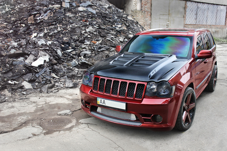 Jeep Grand Cherokee SRT8. Brutal Off Road Car On A Background Of Ruins Of