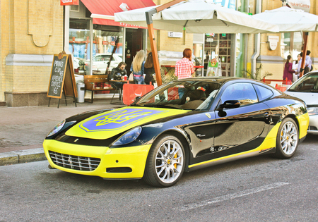 October 8, 2015, Kiev, Ukraine; Ferrari 612 Scaglietti with a Ukrainian flag. Editorial photo.