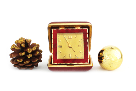 Happy New Year. Christmas composition. Toys and old traveling clock and a Christmas wreath. Clock. Antiques. Leather watches. New Year Stock Photo