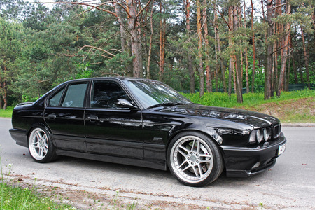 Kiev, Ukraine. May 17, 2014. BMW M5 (E34) against the background of the forest. Editorial photo.