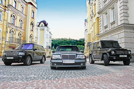 Mercedes E500 W124 Wolf on the background of beautiful old houses. Kiev, Ukraine. September 6, 2013. Editorial photo. Redakční