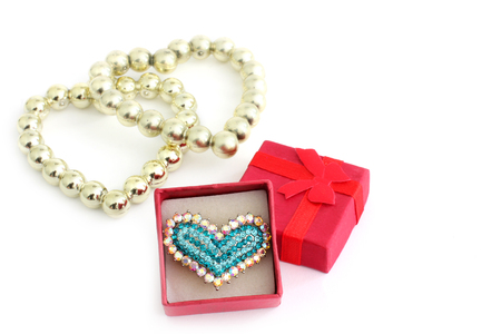 Ring in the form of a heart with jewels. Happy Valentines Day. Valuable Jewelery. Isolated with plenty of room for your text. Love.