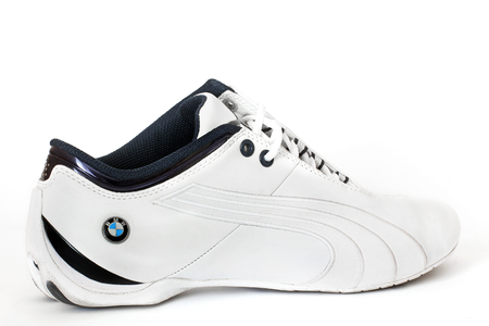 Vinnitsa, Ukraine - October 3, 2017: PUMA. Mens BMW Motorsport Shoes. One sneaker over white background, front view Editorial