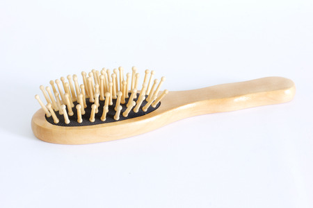 Wooden comb on white background Imagens
