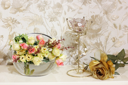 Flowers and candlestick on a white piano