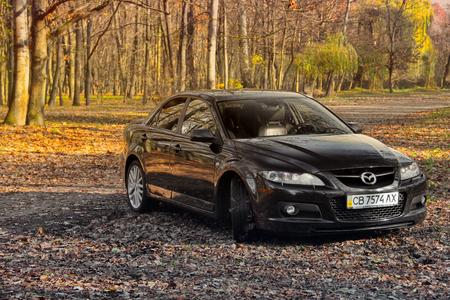 Chernihiv, Ukraine - November 10, 2018: Mazda MPS 6 in the autumn forest