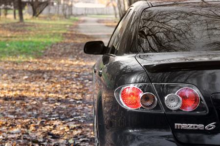 Chernihiv, Ukraine - November 10, 2018: The back of a Mazda MPS car in an autumn park