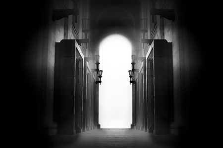 A light in the end of a tunnel. Black and white photo Stock Photo