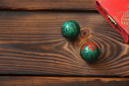 Chinese balls on a wooden background