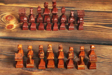 Wooden chess on wooden background