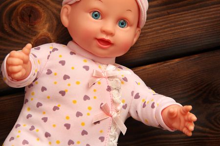 Baby doll on wooden background