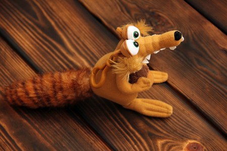 Soft toy on wooden background. Squirrel Stock Photo