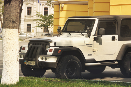 Kiev, Ukraine - May 3, 2019: Jeep Wrangler SUV near the church