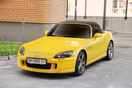 Kiev, Ukraine - May 3, 2019: A yellow supercar Honda S2000 in the city