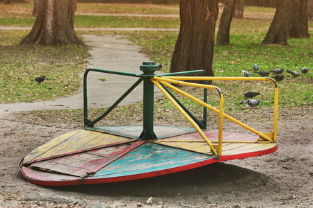 Old swing in the park. Broken swing