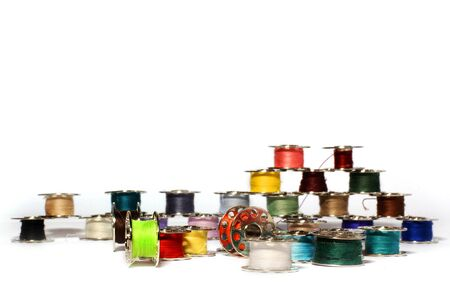 Spools of thread on a white background. For sewing