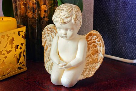 Angel statuette on the bedside table. The scenery in the house
