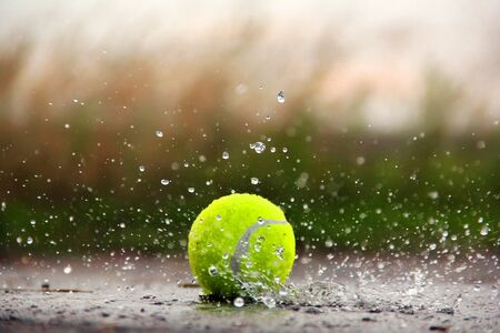 Tennis ball in the water. Tennis Ball and Water Drops Stok Fotoğraf