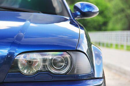 Car headlights. Luxury Headlights. Part of a blue car