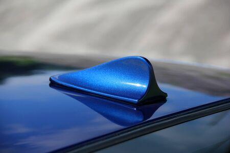 Car antenna. Part of a blue car. Stock Photo