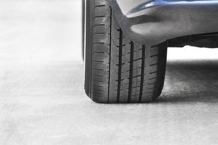 Car wheels on a background of asphalt. Car tires. Car wheel close up Фото со стока