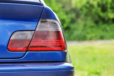 Part of a blue car. Car headlights. Luxury Headlights