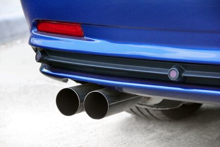 Car exhaust pipes. Rear part of the car