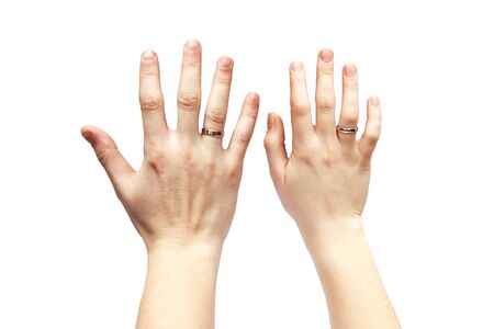 Hands on a white background. Male and female hand on a white background. Rings on the hands.