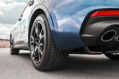 Car on sky background. Car wheels close up on a background of asphalt. Car tires. Car wheel close-up. for advertising Imagens