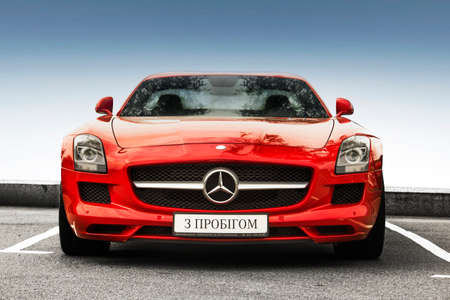 Kiev, Ukraine - May 19, 2020: Luxury supercar Mercedes-Benz SLS AMG against the sky. Wallpaper. For sale. For advertising. Red supercar