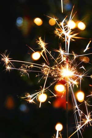 Lights. Sparks. Christmas background. Christmas lights close up. Celebration