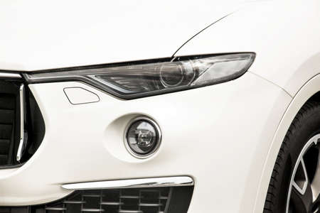 Car headlights. Luxury Headlights. Part of a white car close up. Bumper Stockfoto