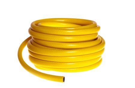 The yellow rubber garden hose Stock Photo