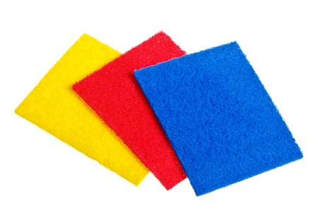 Multicolored sponges for dishwashing isolated on a white background. Stock Photo