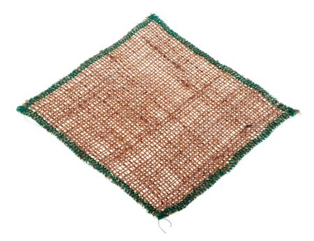 Tablecloth from burlap, isolated on a white background.