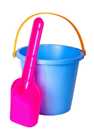 Childrens bucket and shovel, isolated on a white background. photo