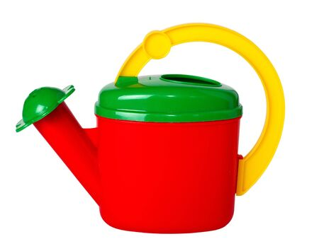 Childrens multicolored watering can, isolated on a white background. photo