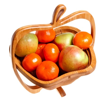Basket of apples and tangerines isolated on a white background. Stock Photo - 12365572