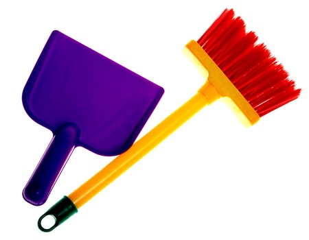 Toy plastic dustpan and broom isolated on a white background. Stock Photo