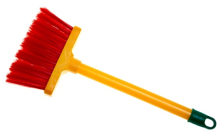 Childrens toy plastic broom isolated on white background.