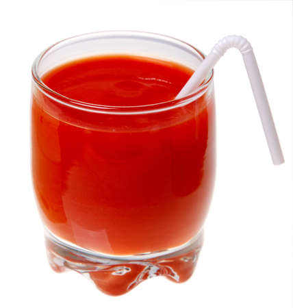 A glass of tomato juice and a straw isolated on a white background.