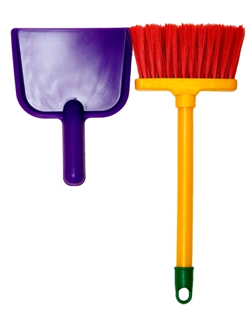 sweeping: Toy plastic dustpan and broom isolated on a white background. Stock Photo