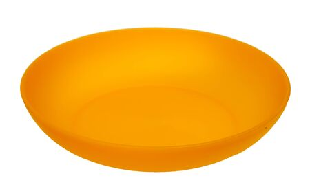 Yellow plastic plate, isolated on a white background